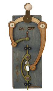 Lightswitch with wooden gears and levers to turn the off on switch into a right left lever