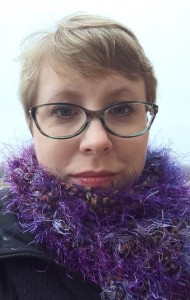 Close up of Elyse with a purple fluffy scarf