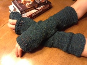 Green Arm Warmers modeled by Anne Calhoun.