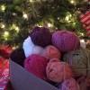 A box of yarn under the lights of the christmas tree