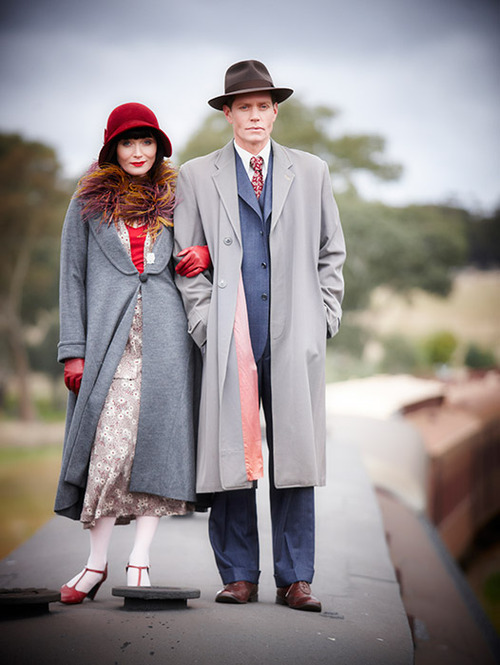 98482e38b4e3a Phryne and Detective Inspector Jack Robinson atop a train. He s the one not  wearing red
