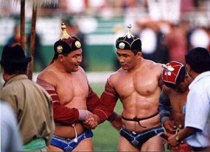 Two Mongoloian wrestlers checking each other out.