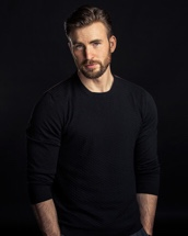 Chris Evans in a black sweater looking really pretty hot