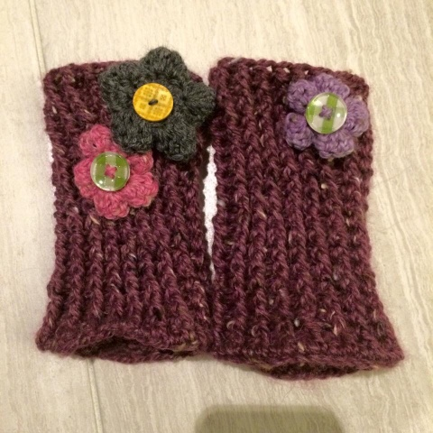 close up of button flowers and purple yarn wristlets