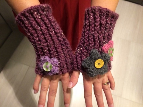 Carrie wearing new purple wristlets with button flowers - they're very cute