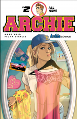 Betty in a ballcap holding up a dress in front of the mirror with another dress over her arm, her lips pursed to the side. Around the edge of the mirror are pictures and mementos of her relationship with archie