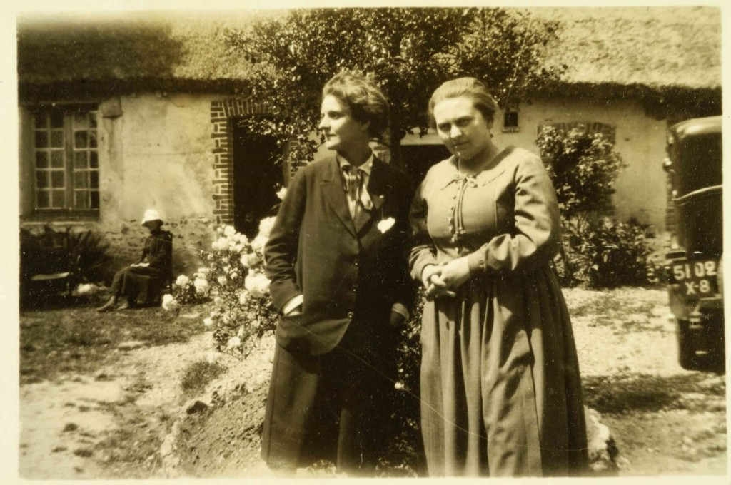 Sylvia and Adrienne, a black and white photograph showing both women in a garden or courtyard