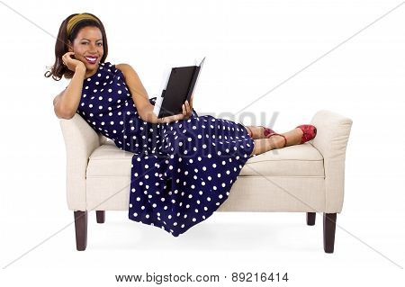 Same woman, still lounging, this time with a huge smile on her face