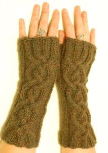 braided wrist warmers with thumb holes, with two long braids down the back of each wrist