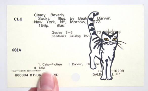 A painted illustration of Socks the cat on the library card catalog entry card for Socks by Beverly Cleary