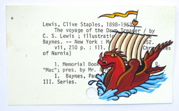 A painting of the red and gold dawn treader ship with dragon head and sail painted on the library card catalog entry for the book