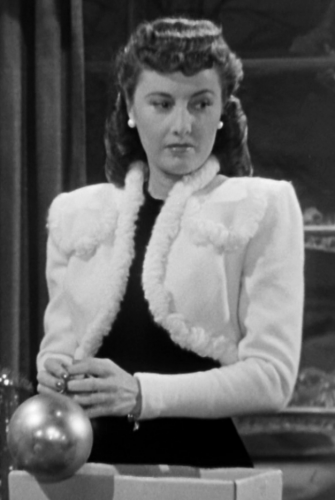 Elizabeth wearing a white, fur bolero.