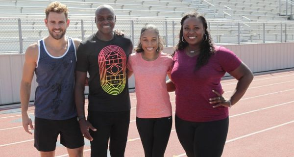 Nick poses for a picture with Michelle Carter, Carl Lewis and Allyson Felix.