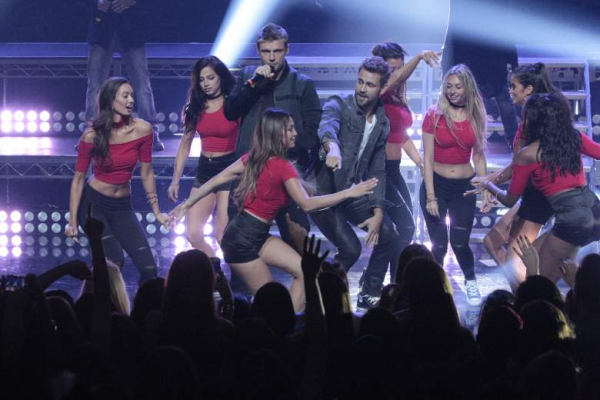 Nick Viall dances onstage with Nick Carter and the ladies.
