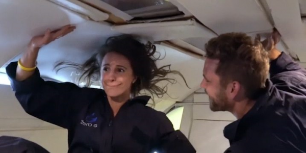 Nick and Vanessa float weightless in a zero g plane.