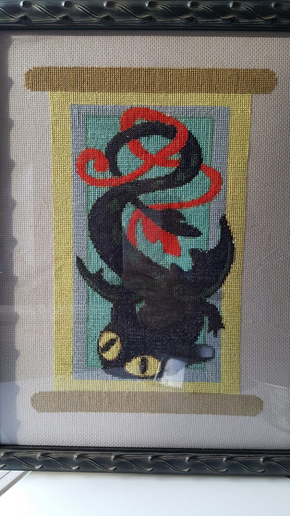 The Toothless banner cross stitch pattern I commissioned and made. Took me over a year off and on.