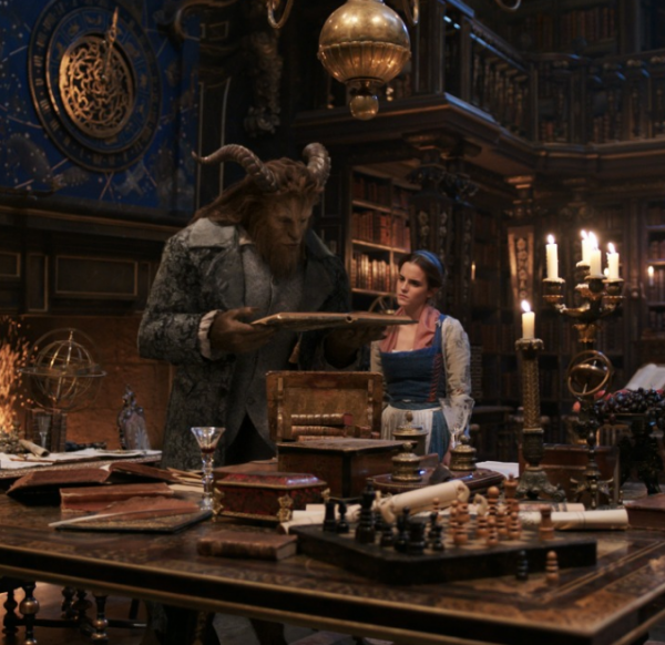 Belle and the beast standing in his hella wow library