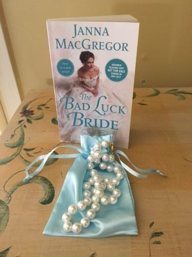 A string of pearls and a copy of The Bad Luck Bride