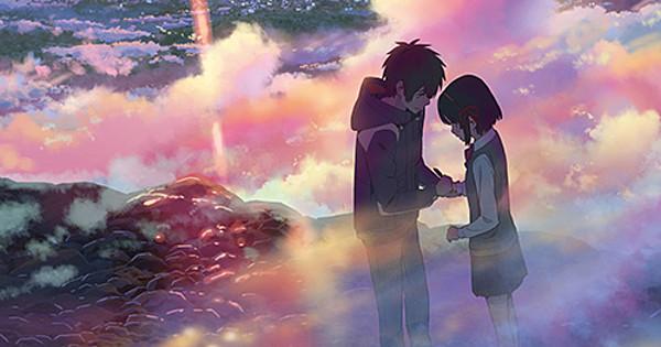 Taki and Mitsua on a mountain at sunset