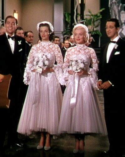 Lorelei and Dorothy's matching tea-length, lace wedding dresses.