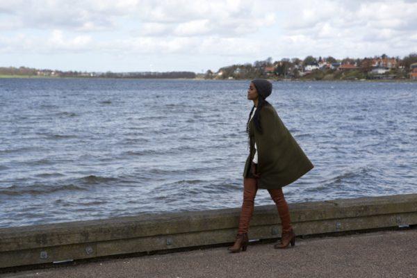 Rachel walks along the watefront in Denmark.