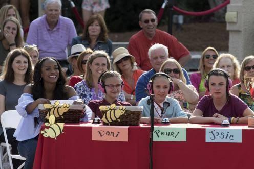 Three 12 year old girls help Rachel judge the spelling bee.