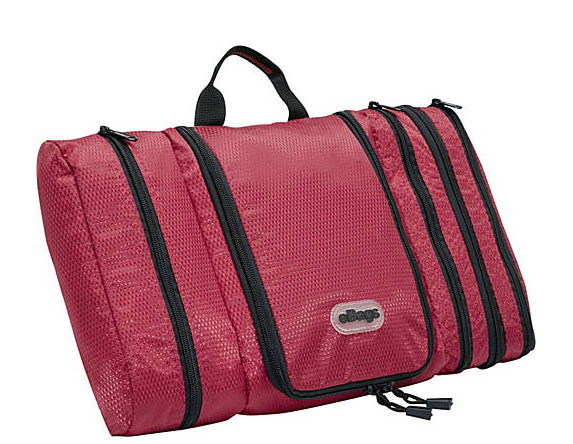 eBags Pack it Flat toiletry kit a raspberry colored bag with one large main compartment and three side compartments. it is about 2 inches thick