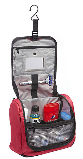 The Portage toiletry kit, which has a trangular shape with a wide bottom and a hook for hanging on the inside front lid