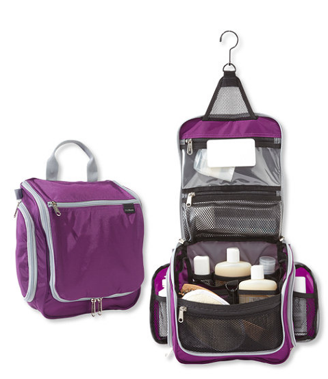 A purple zipper bag that unfolds to hang on the wall with two separate side zipper pockets