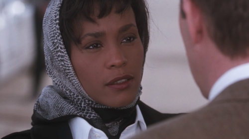 Whitney Houston lovingly looking at Frank as she says goodbye