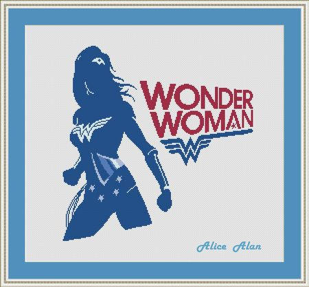 A dark blue shadow of Wonder Woman stands fiercely, her logo, the stars on her outift and her headband glow white. Her logo and name are stitched next to her in blue and red.