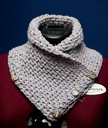 A gray cowl that buttons in the front.
