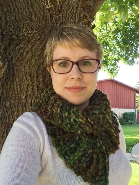 A picture of me, modeling an Outlandish cowl. I'm outside standing by a tree.