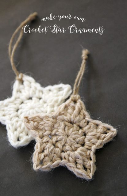 Two crocheted star ornaments are displayed against a gray background.