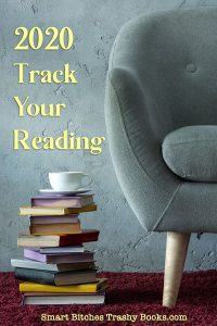 a fuzzy grey chair with a stack of books on the floor and a teacup on top with the words 2020 Track Your Reading and the Site URL at the bottom