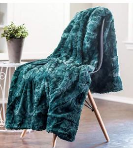 Teal fleece throw SO FLUFFY on a chair