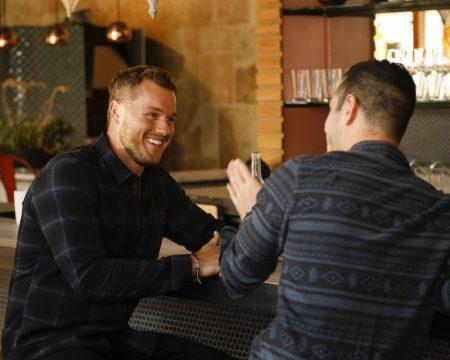 Colton and Ben sit at a bar and talk.
