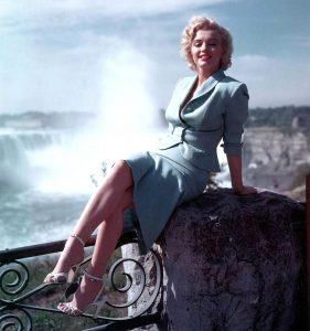 Marilyn Monroe in front of the Falls in a Blue suit