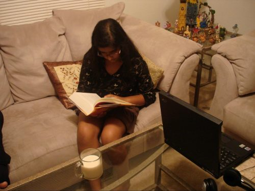 Aarya reading on a couch