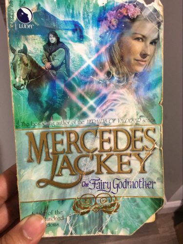 A well-worn copy of The Fairy Godmother by Mercedes Lackey