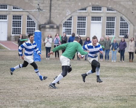 An action shot of the dudes playing rugby