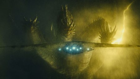 King Ghidorah stares down a military jet. He looks like a hydra with dragon wings and he breathes lightning.