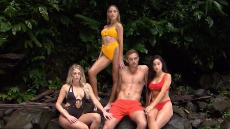 Peter and three of the women model swimwear and Crocs against a jungle background