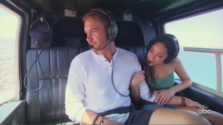 Peter and Victoria ride in a helicopter