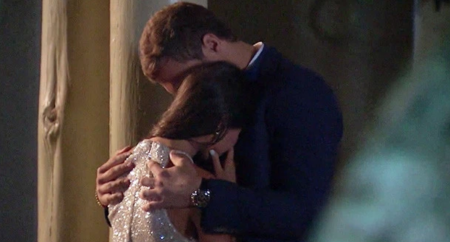 Peter hugs Madison while she cries.