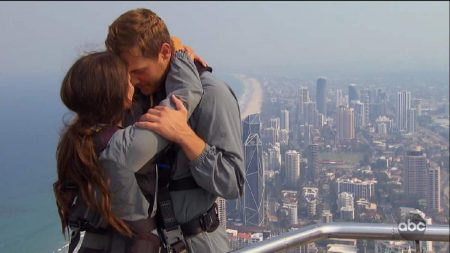 Peter and Madison make out on the top of a really tall building