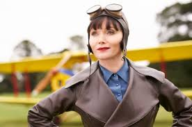 Phryne in aviator gear