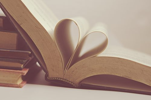 Pages of a book folded into a heart shape