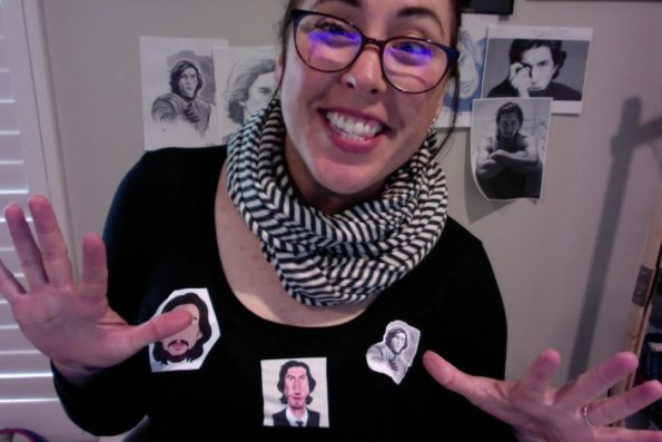 Lauren from Christina Lauren wearing a black shirt with pictures of adam driver ironed on to the front, and pictures of Adam Driver taped to the wall behind her, for Amanda's birthday.