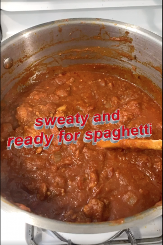 A big pot of pasta sauce with the caption 'sweaty and ready for spaghetti'
